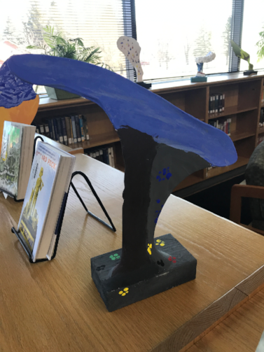 Student art work on display in the library.